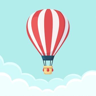 Balão de ar quente no céu com nuvens.