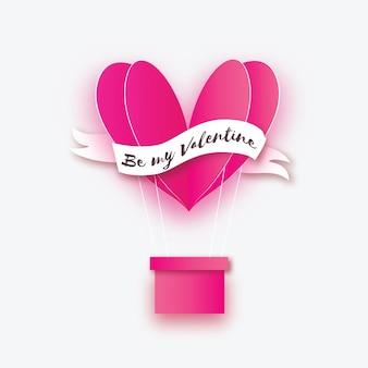 Balão de ar quente rosa em forma de coração voando