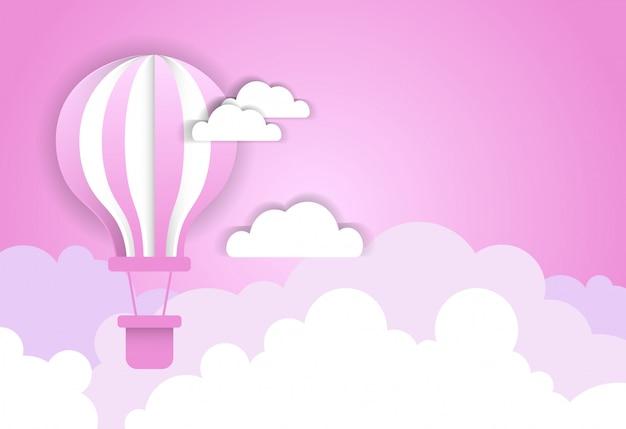 Balão de ar sobre nuvens cor de rosa