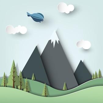 Balão de ar voando na paisagem de pinheiros no estilo de arte de papel