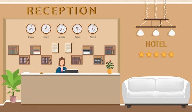 Balcão de recepção do hotel com recepcionista e sofá.