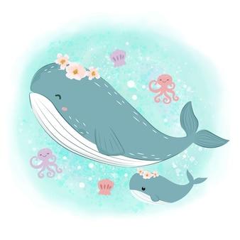 Baleia mamãe fofa e baleia bebê no oceano
