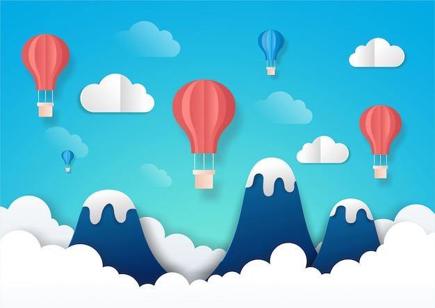 Balões de ar coloridos flutuando acima da montanha