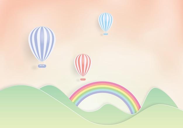 Balões de ar quente coloridos que voam sobre a montanha, corte do papel