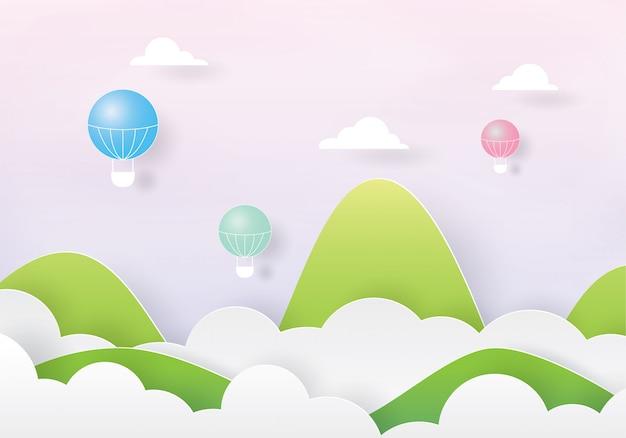 Balões de ar quente coloridos voando sobre a nuvem e a montanha