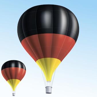 Balões de ar quente pintados com a bandeira da alemanha