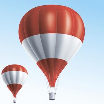 Balões de ar quente pintados com a bandeira da áustria