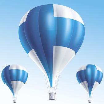 Balões de ar quente pintados com a bandeira da finlândia