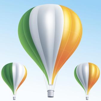 Balões de ar quente pintados como a bandeira da irlanda