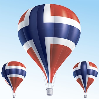 Balões de ar quente pintados como a bandeira da noruega