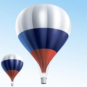Balões de ar quente pintados como a bandeira da rússia