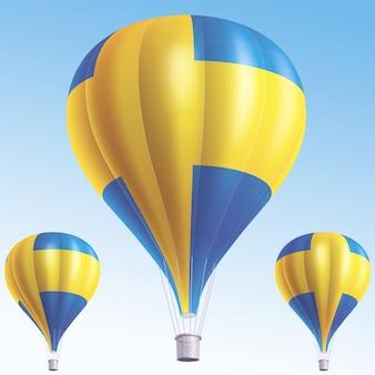 Balões de ar quente pintados como a bandeira da suécia
