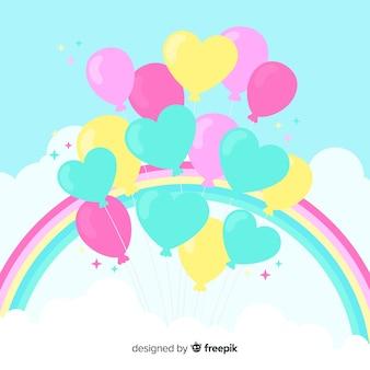 Balões de coração com fundo do arco-íris