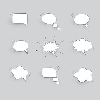 Balões de fala de papel isolados em fundo cinza
