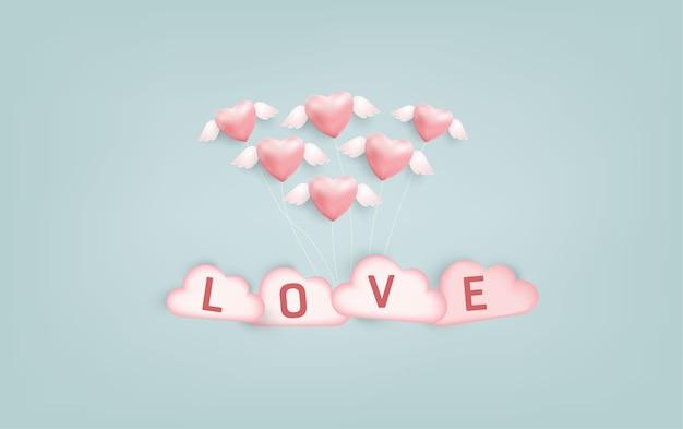 Balões de forma de coração com mensagem de amor.
