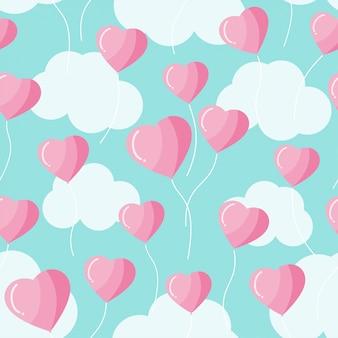 Balões de forma de coração e nuvens rosa e azul pastel padrão sem emenda