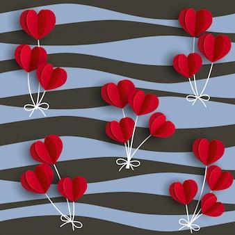 Balões de forma de corações vermelhos em fundo ondulado
