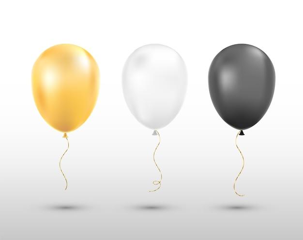 Balões pretos, brancos e dourados isolados.
