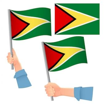 Bandeira da guiana na mão conjunto