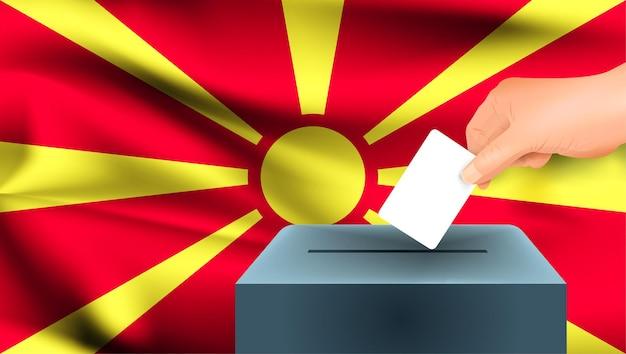 Bandeira da macedônia, votação de mão masculina com fundo de ideia de conceito de bandeira da macedônia