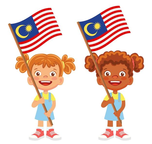 Bandeira da malásia na mão. crianças segurando uma bandeira. vetor da bandeira nacional da malásia