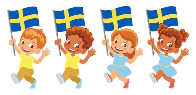 Bandeira da suécia na mão. crianças segurando uma bandeira. bandeira nacional da suécia Vetor Premium