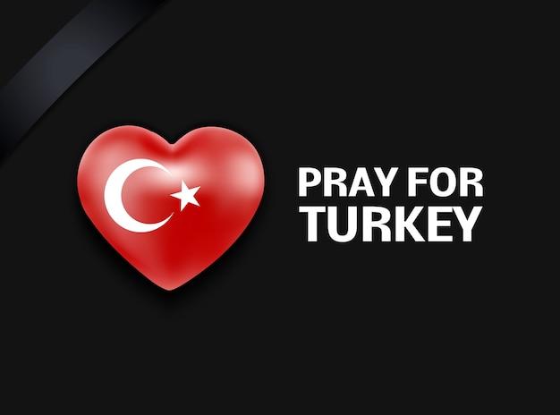 Bandeira da turquia no formato de um coração com uma faixa de fita de luto ore pelo terremoto de luto nacional da turquia em um fundo preto