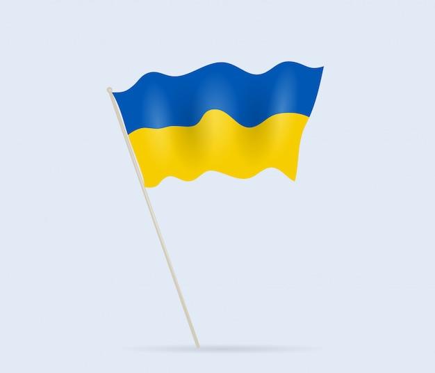 Bandeira da ucrânia no mastro da bandeira balançando ao vento.