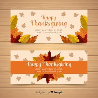 Bandeira de ação de graças feliz definida no projeto liso com folhas de outono