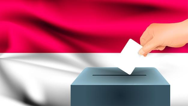 Bandeira de mônaco, votação de mão masculina com fundo de ideia de conceito de bandeira de mônaco