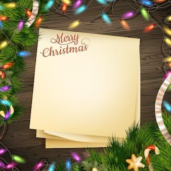 Bandeira de papel nota para férias saudação mensagem e decoração de natal em um fundo de madeira.