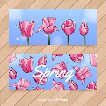 Bandeira de primavera mão desenhada tulipas