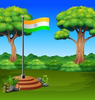 Bandeira dos desenhos animados da índia em uma natureza verde