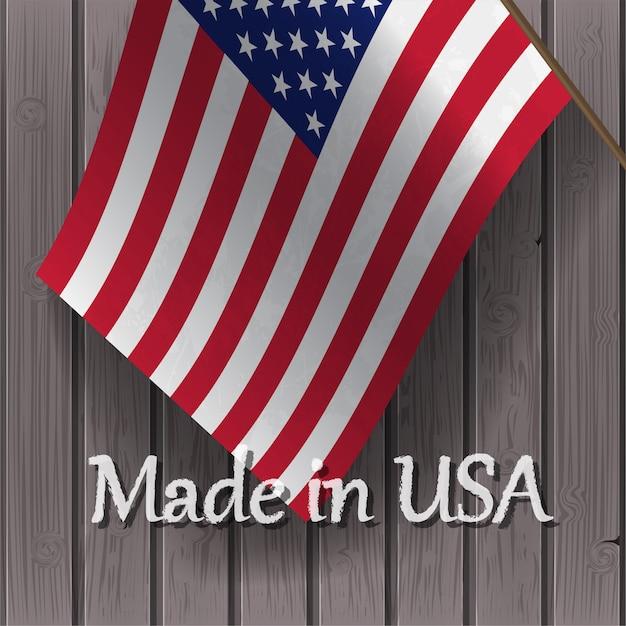 Bandeira dos estados unidos e as palavras made in usa em uma placa de madeira