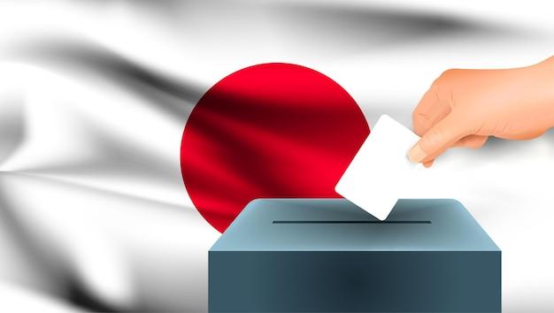 Bandeira japonesa, uma mão masculina votando com o fundo da bandeira do japão