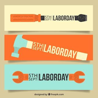 Bandeiras ajustadas do dia ferramentas de trabalho