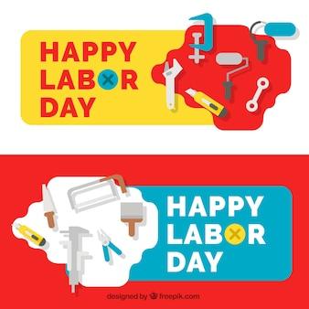 Bandeiras do dia de trabalho com ferramentas