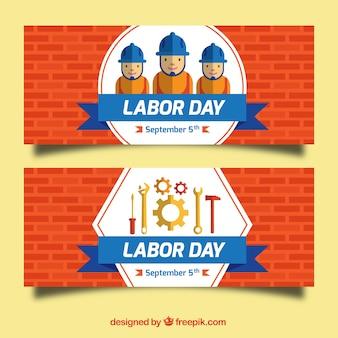 Bandeiras do dia de trabalho de paredes de tijolo