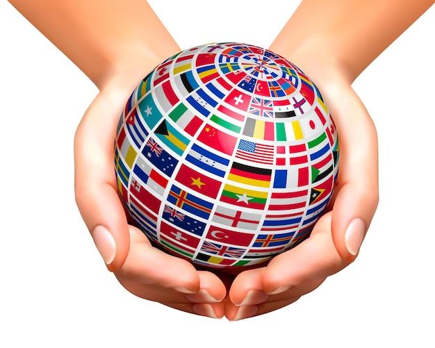 Bandeiras do mundo em um globo, mantidas nas mãos. ilustração.