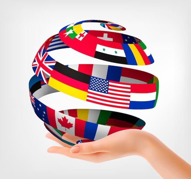 Bandeiras do mundo em um globo, na mão. ilustração.