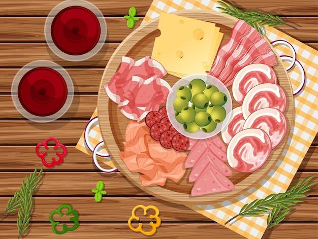 Bandeja de frios e carnes defumadas no fundo da mesa