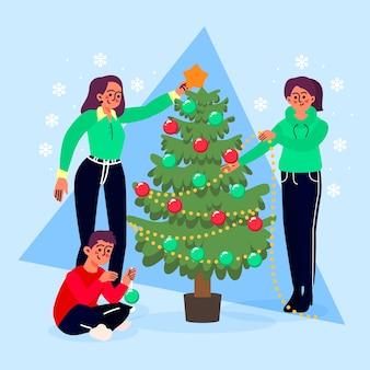 Bando de pessoas decorando a árvore de natal