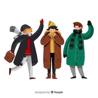 Bando de pessoas vestindo roupas de inverno