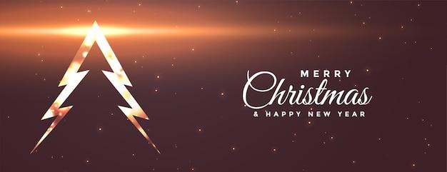 Banner brilhante com árvore de natal feliz com efeito de luz Vetor grátis