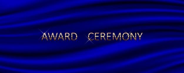 Banner da cerimônia de premiação com fundo de seda azul