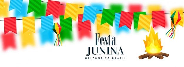 Banner de celebração junina festa colorida com design de fogueira