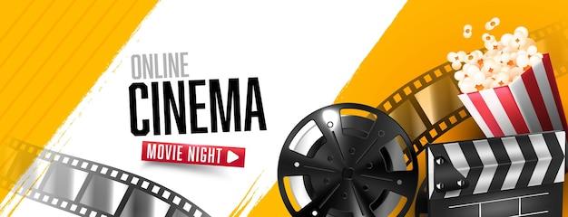 Banner de cinema online com claquete aberta e tira de filme