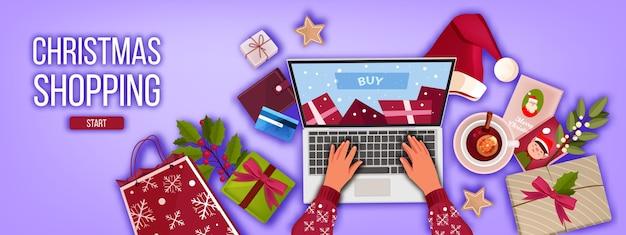 Banner de compras on-line de inverno de natal com vista superior do laptop, mãos, presentes, bolsa, chapéu de papai noel