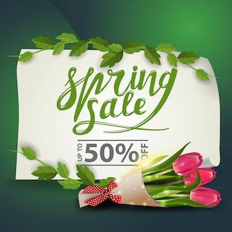 Banner de desconto de venda de primavera com buquê de tulipas