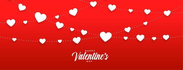 Banner de dia de vallentines vermelhos com corações brancos